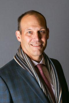 Andrew B Dossett
